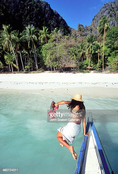 Woman jumping from boat