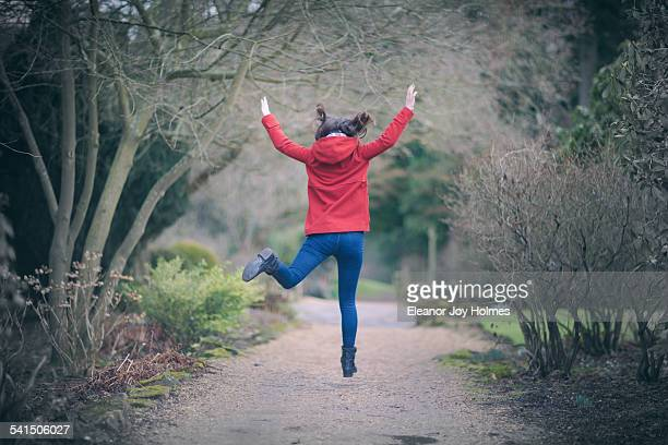 Woman jumping in a park