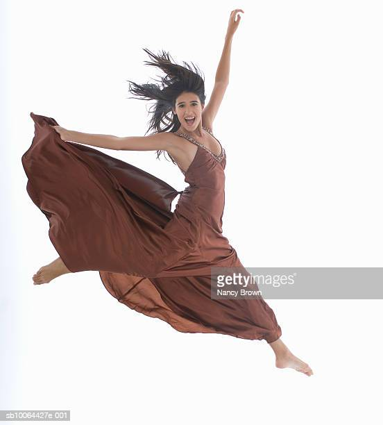 woman jumping in air on white background - legs apart stock pictures, royalty-free photos & images