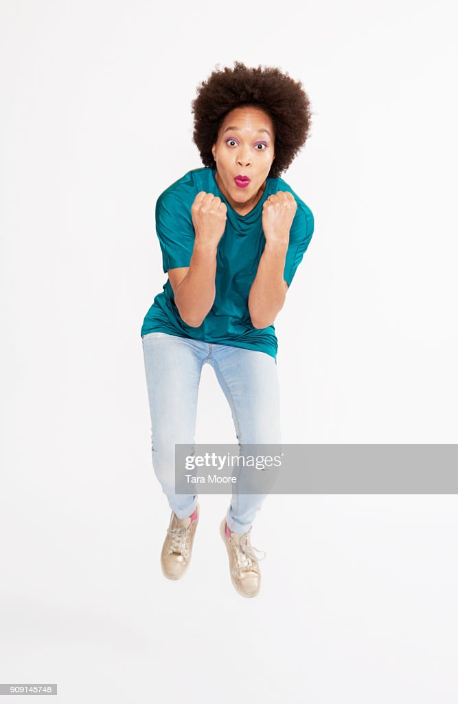 woman jumping in celebration : Stock Photo