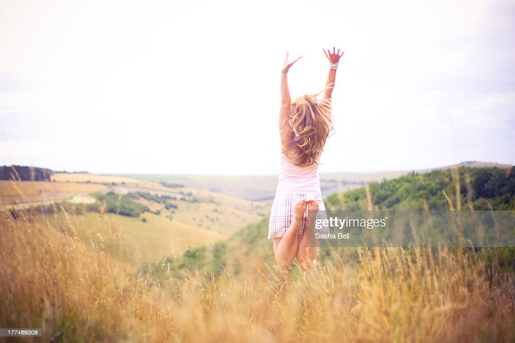 Woman jumping in English countryside : Stock Photo