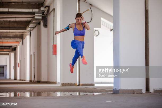 Woman jumping in hallway
