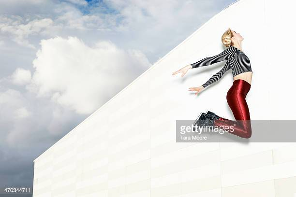 woman jumping in sky