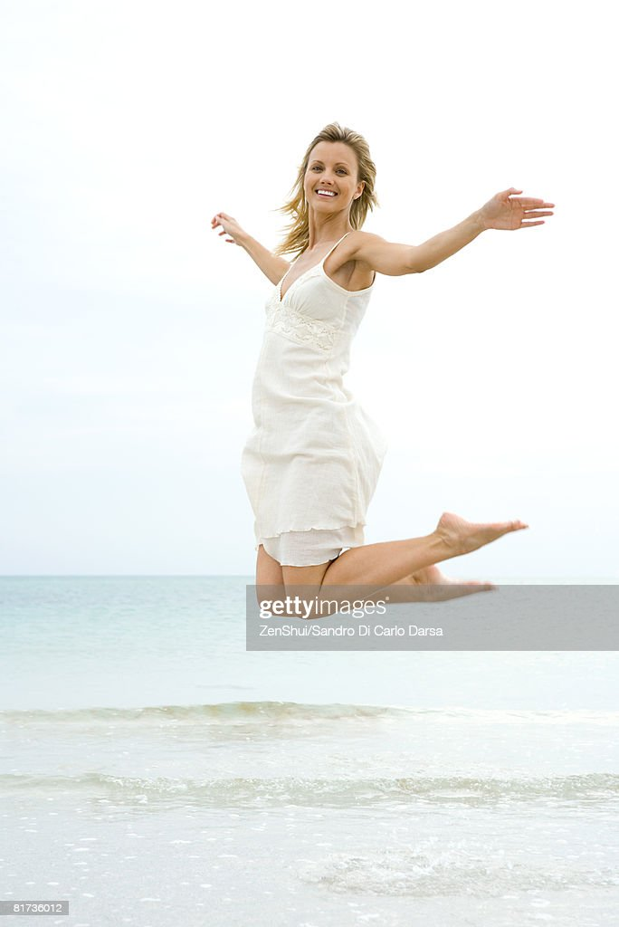 Woman jumping in the air