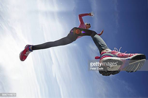 woman jumping in the air, sport , trainers - low angle view stock pictures, royalty-free photos & images