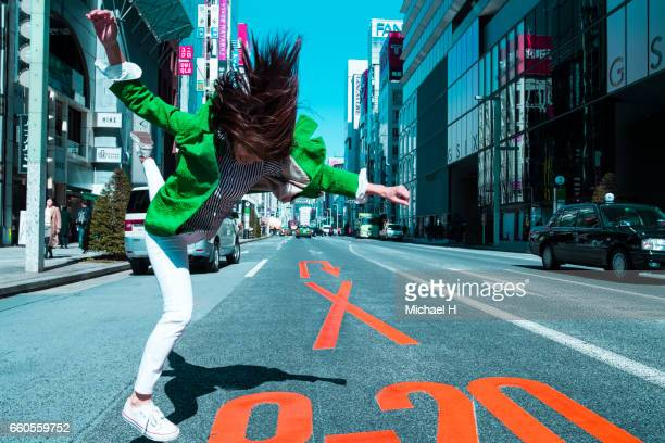 Woman jumping in the city