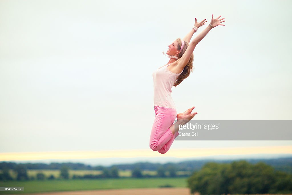 Woman Jumping in the Countryside : Stock Photo