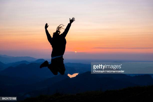 Woman jumping in the mountains