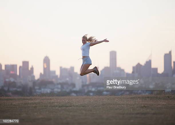 Woman jumping in urban park