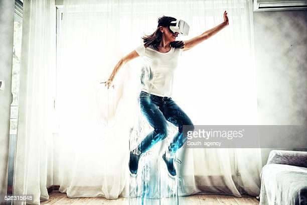 Woman jumping in virtual world