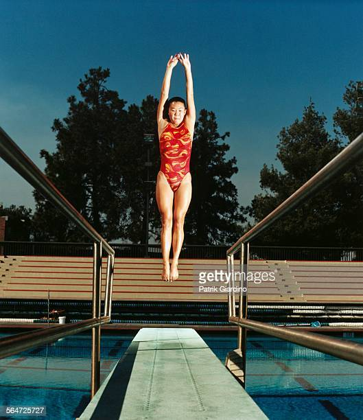 Woman Jumping off Diving Board