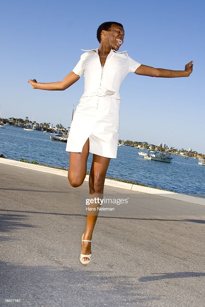 Woman Jumping On One Foot Stock Photo - Getty Images