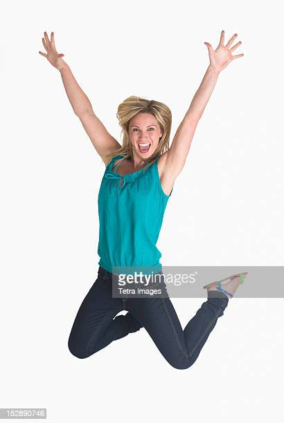 Woman jumping on white background