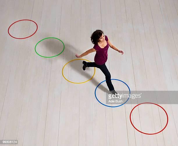 Woman jumping over circles