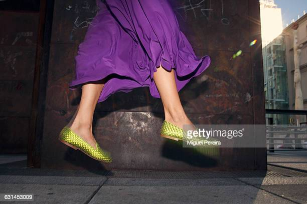 woman jumping - purple shoe stock pictures, royalty-free photos & images