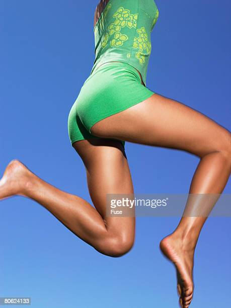 woman jumping - beautiful bums stock pictures, royalty-free photos & images