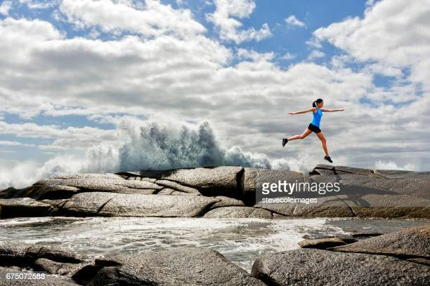 Woman Jumping Rock to Rock