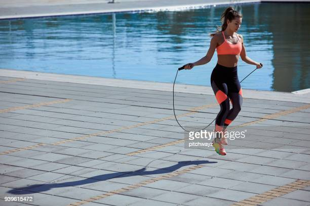 woman jumping the rope. - skipping along stock pictures, royalty-free photos & images