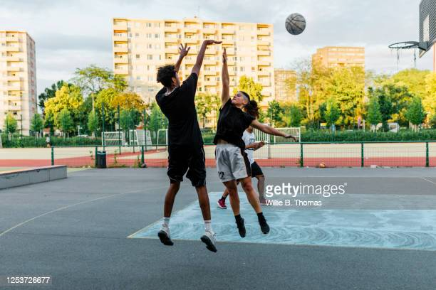 woman jumping to block a shot - try scoring stock pictures, royalty-free photos & images