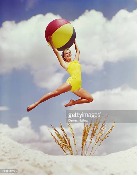 Woman Jumping with Colorful Beach Ball