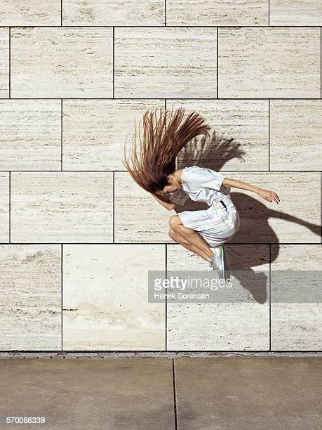 woman jumping with hair flying out - beige dress stock pictures, royalty-free photos & images