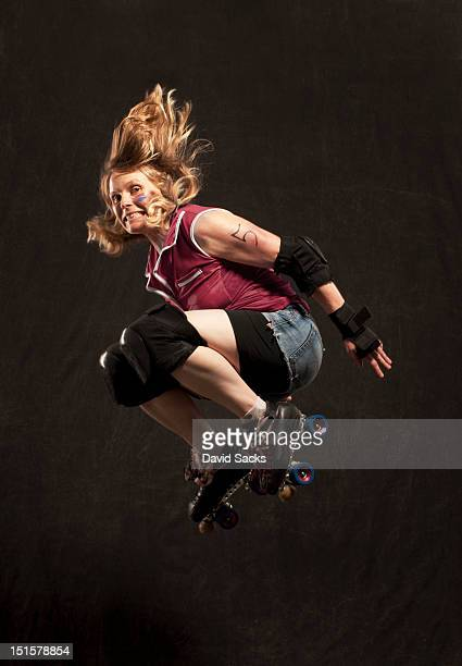 Woman jumping with skates