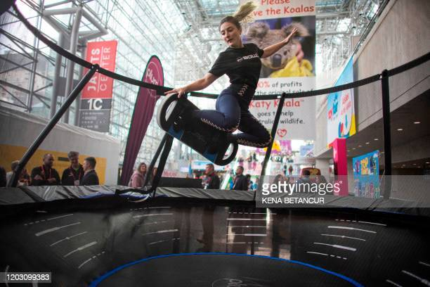 A woman jumps on a plum bowl trampoline during the annual toy fair at the Javitz Center on February 24 2020 in New York City There is no China...