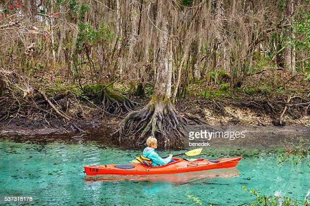 Woman Kayaking at Spring in Crystal River Florida USA