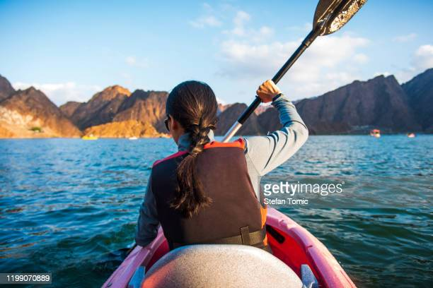 woman kayaking in a lake closeup - kayak stock pictures, royalty-free photos & images