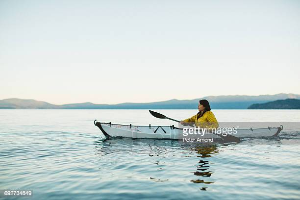 Woman kayaking on Lake Tahoe, California, USA