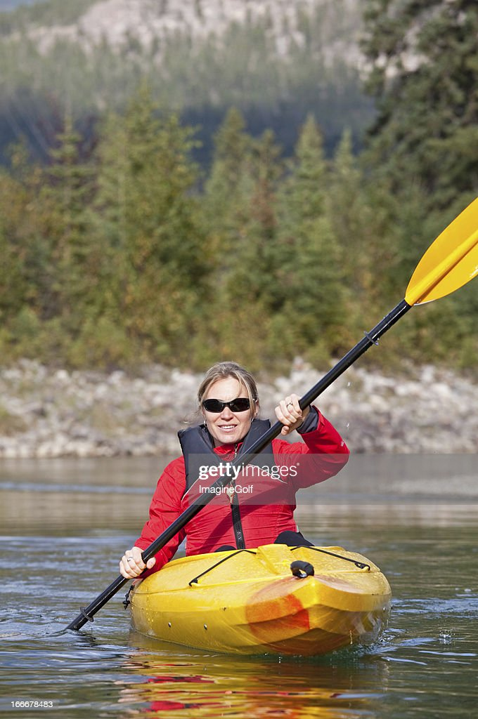 woman kayaking stock photo getty images