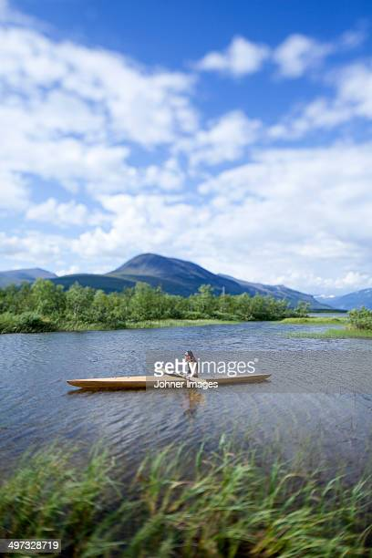 Woman kayaking, Sweden