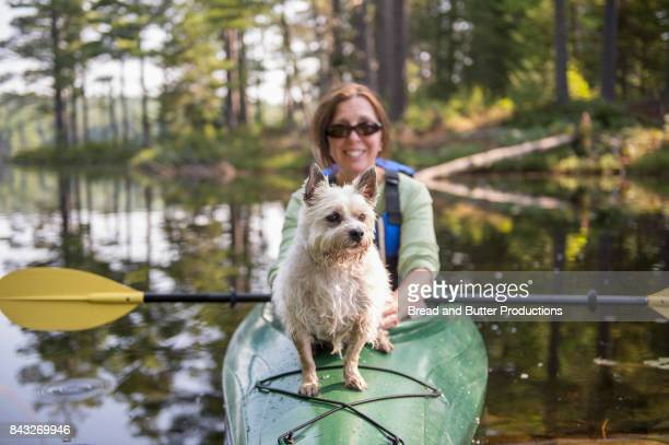 Woman Kayaking with her Dog