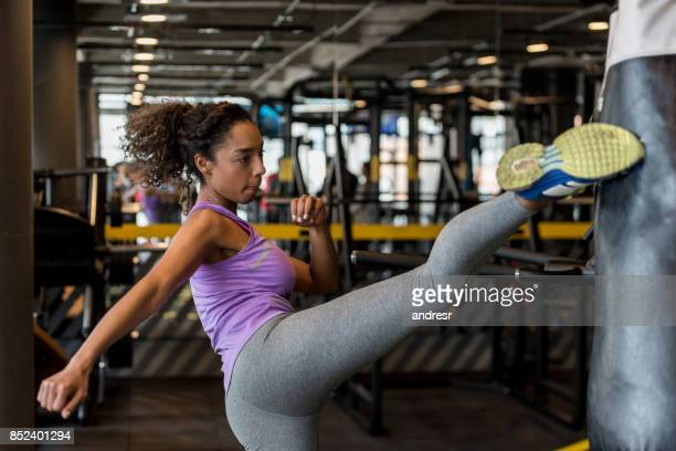 Woman kickboxing at the gym