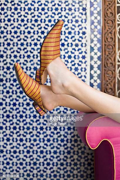 woman kicking off slippers - hugh sitton stock-fotos und bilder