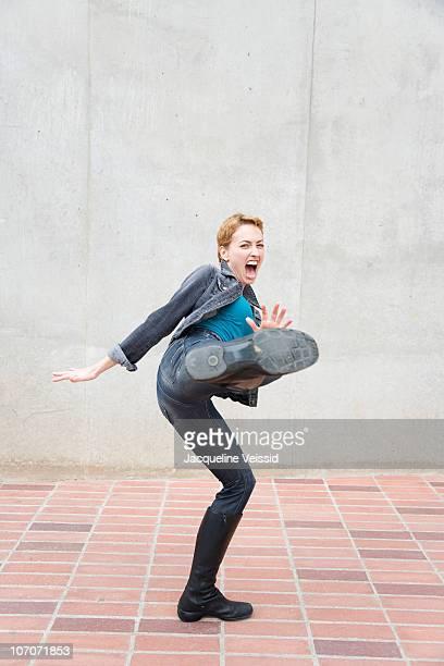 woman kicking  - kicking ストックフォトと画像