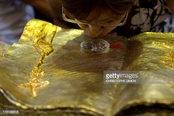 A woman kisses a relic after a mass officiated by Cardinal Stanislaw Rylko to celebrate the arrival in Brazil of the relics of blessed John Paul II...