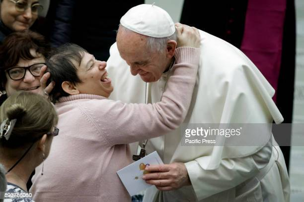 A woman kisses Pope Francis during the Weekly General Audience in Paul VI Hall in Vatican City Vatican