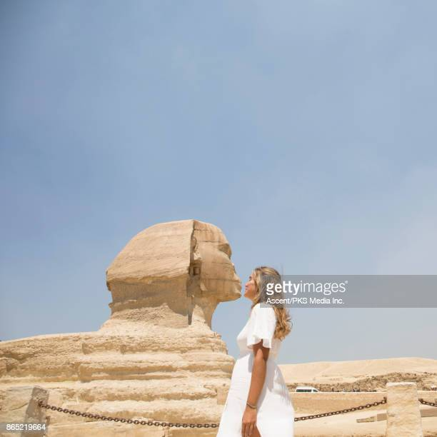 Woman 'kisses' the Great Sphinx of Giza, Giza, Egypt