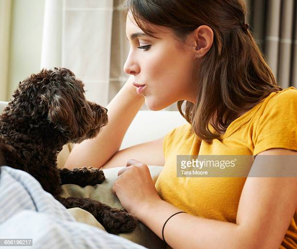 woman kissing dog