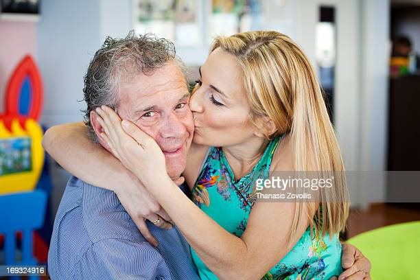 Woman kissing her father