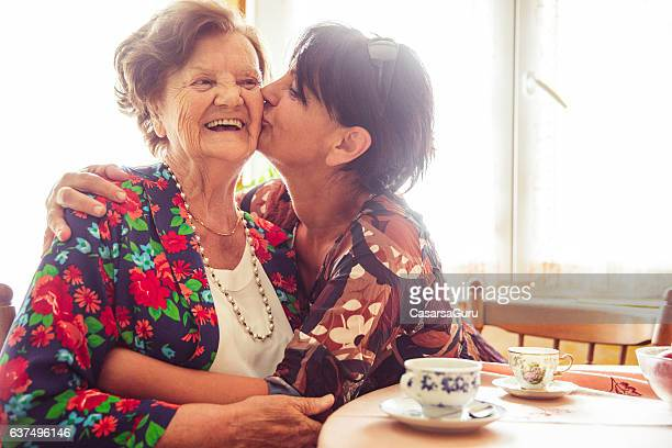 Woman Kissing Her Mother on Cheek