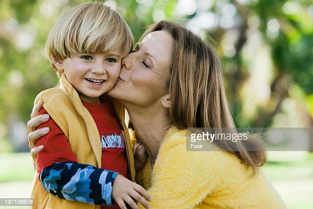 Woman kissing her son's cheek