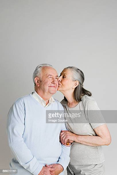 Woman kissing husband