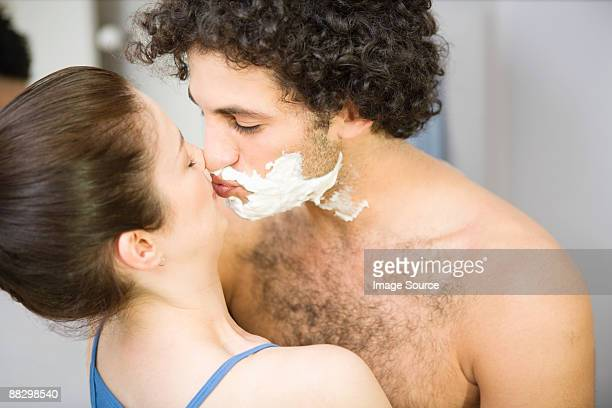 woman kissing man with shaving foam - couple and kiss and bathroom stock photos and pictures