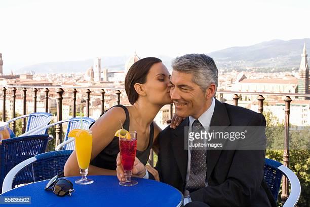 Woman kissing man's cheek, Florence, Italy