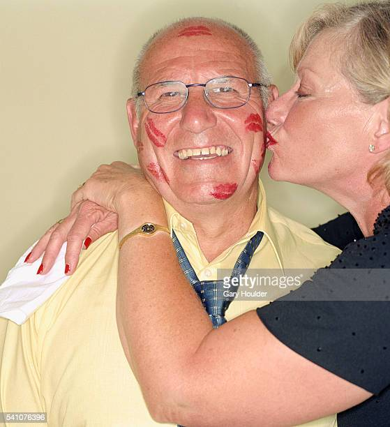 Woman Kissing Man's Face