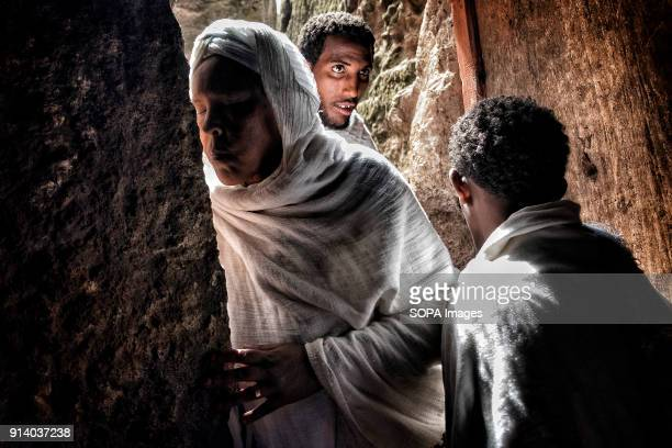 A woman kissing the wall of the Biete Denagel before entering During the first days of January thousands of Ethiopian Orthodox Christian pilgrims go...