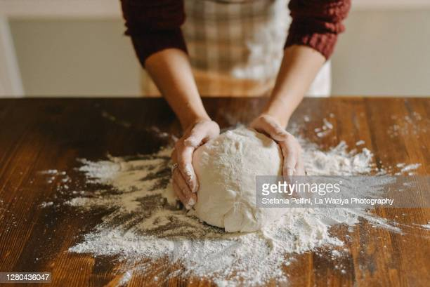 woman kneading bread dough - freshness stock pictures, royalty-free photos & images