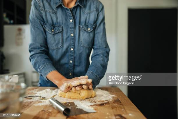 woman kneading dough in kitchen - ingredient stock pictures, royalty-free photos & images
